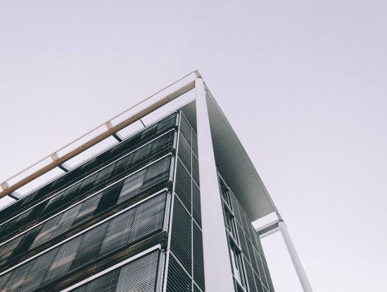 low-angle-shot-corner-high-business-building_181624-1472