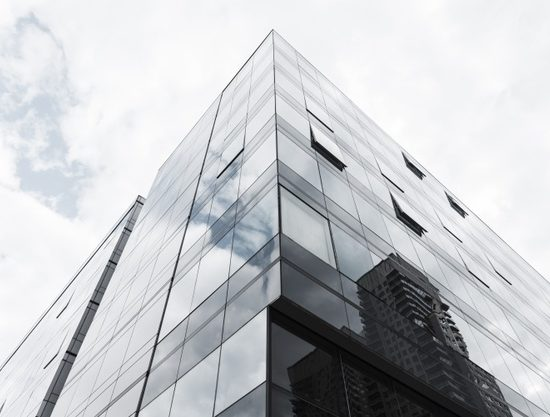 low-angle-view-glass-designed-building_23-2148230408
